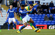 Lewis Grabban battles with David davis during the Sky Bet Championship match between Birmingham City and Norwich City at St Andrews, Birmingham, England on 31 January 2015. Photo by Alan Franklin.
