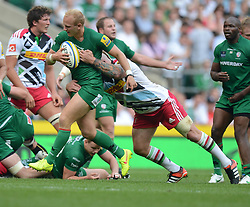 London Irish Fly-Half Shane Geraghty gets tackled by Harlequins Prop Joe Marler (capt)  - Photo mandatory by-line: Alex James/JMP - 07966 386802 - 06/09/2014 - SPORT - RUGBY UNION - London, England - Twickenham Stadium - Saracens v Wasps - Aviva Premiership London Double Header.