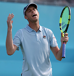 USA's Sam Querrey reacts during day one of the Fever-Tree Championship at the Queens Club, London.