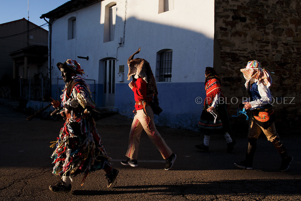 (L-R) Men dressed as La Filandorra, El Diablo, La Madama and El Galan walk the streets during La Filandorra festival on December 26, 2016 in the small village Ferreras de Arriba, Zamora province, Spain.  La Filandorra festival is a pagan winter masquerade that takes place during Saint Esteban festivities. The parade is represented by four characters, La Filandorra, El Diablo (Devil), La Madama (madame) y El Galán (Gallant). (© Pablo Blazquez)