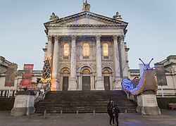 "© Licensed to London News Pictures. 30/11/2018. LONDON, UK.  The new Tate Britain Winter Commission, devised by the Turner Prize nominated artist Monster Chetwynd, is unveiled.  The artist, formerly known as ""Marvin Gaye"" and ""Spartacus"", has transformed Tate Britain's iconic Neo-Classical façade to mark the winter season with a new piece inspired by the winter solstice, involving a dazzling light display and elements of sculpture.  Winter Commission 2018: Monster Chetwynd will be switched on daily from 1st December 2018 - 28 February 2019.  Photo credit: Stephen Chung/LNP"