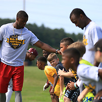 AARON STEWART || BUY AT PHOTOS.DJO<br /> Pro football player and former MSU Bulldog Johnthan Banks gets kids in line for a drill at the All-Star Football Camp benefiting the Boys & Girls Club Saturday Morning.