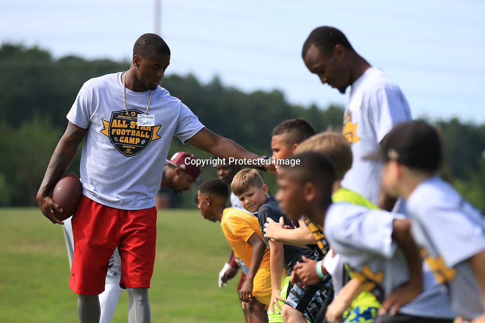 AARON STEWART || BUY AT PHOTOS.DJO<br /> Pro football player and former MSU Bulldog Johnthan Banks gets kids in line for a drill at the All-Star Football Camp benefiting the Boys &amp; Girls Club Saturday Morning.