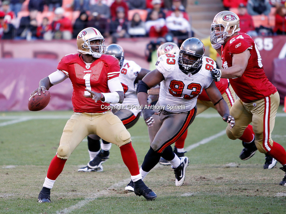 San Francisco 49ers quarterback Troy Smith (1) gets pressured on a pass play by Tampa Bay Buccaneers defensive tackle Gerald McCoy (93) during the NFL week 11 football game against the Tampa Bay Buccaneers on Sunday, November 21, 2010 in San Francisco, California. The Bucs won the game 21-0. (©Paul Anthony Spinelli)