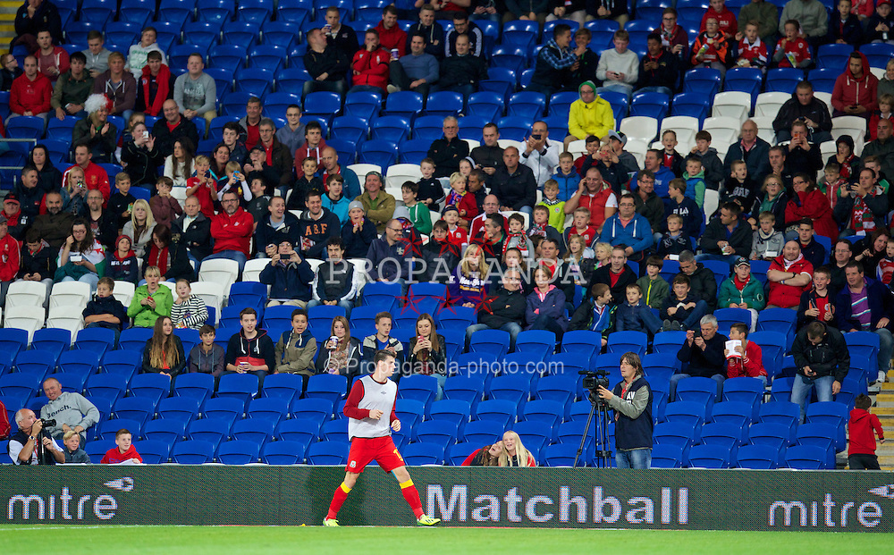 CARDIFF, WALES - Tuesday, September 10, 2013: Wales' substitute Gareth Bale warms-up in front of supporters during the 2014 FIFA World Cup Brazil Qualifying Group A match against Serbia at the Cardiff CIty Stadium. (Pic by David Rawcliffe/Propaganda)