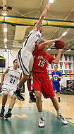 Linn-Mar's Matt Lassen (10) tries to block a shot by Assumption's Matt Vonderhaar (15) during the 2013 Eastern Iowa All-Star Basketball Game at Iowa City West High School in Iowa City on Wednesday, March 27, 2013. The South (dark) defeated the North (white) 87-79.