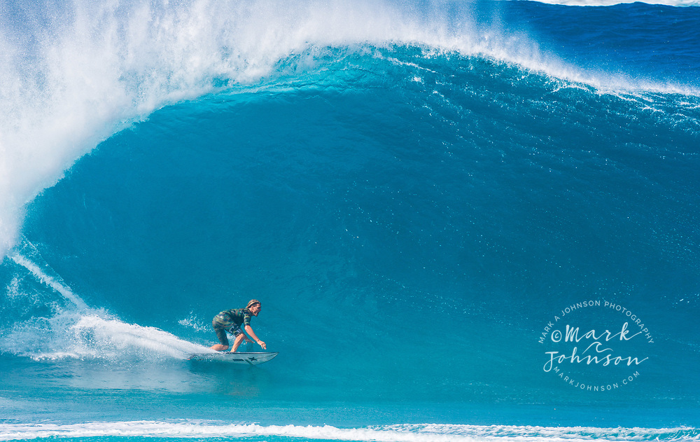 Koa Smith bottom turning on a big wave at the Banzai Pipeline, North Shore, Oahu, Hawaii