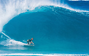 Koa Smith bottom turning on a big wave at the Banzai Pipeline, North Shore, Oahu, Hawaii