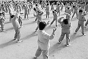 Photograph by Torin Boyd<br /> <br /> Photo taken at the Wakayama Prison where 600 female inamtes are interred. This prison is overcrowded, a sign of Japan's rising crime rate as a result of over a decade of economic stagnation. This photo shows inmates during their daily exercise routine, which takes place in the early afternoon. On this day, they were dancing the samba.. Photo taken February 8, 2003.