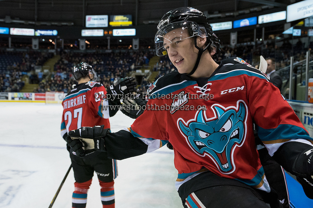 KELOWNA, CANADA - DECEMBER 7: Conner Bruggen-Cate #20 of the Kelowna Rockets sit son the boards and celebrates a first period goal by Calvin Thurkauf #27 against the Seattle Thunderbirds on December 7, 2016 at Prospera Place in Kelowna, British Columbia, Canada.  (Photo by Marissa Baecker/Shoot the Breeze)  *** Local Caption ***