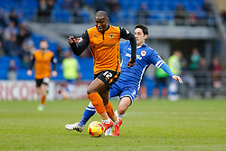 Benik Afobe of Wolverhampton Wanderers is fouled by Peter Whittingham of Cardiff City - Photo mandatory by-line: Rogan Thomson/JMP - 07966 386802 - 28/02/2015 - SPORT - FOOTBALL - Cardiff, Wales - Cardiff City Stadium - Cardiff City v Wolverhampton Wanderers - Sky Bet Championship.