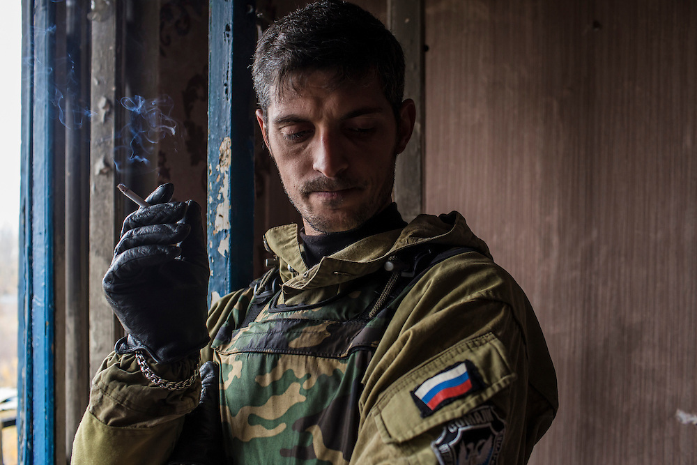 Pro-Russian rebel commander Mikhail Sergeevich Tolstikh, known as Givi, in an apartment building where his forces can observe and coordinate fighting to gain control of the Donetsk airport on Friday, October 17, 2014 in Donetsk, Ukraine. Photo by Brendan Hoffman, Freelance