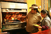 Husband and wife team at a Pollo A la Brasa Restaurant, Cusco, Peru.