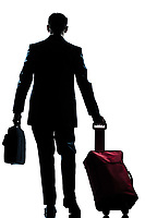 rear view one caucasian business traveler man walking with suitcase  full length silhouette in studio isolated white background