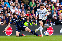 Stuart Dallas of Leeds United slides in to tackle Harry Wilson of Derby County - Mandatory by-line: Ryan Crockett/JMP - 11/05/2019 - FOOTBALL - Pride Park Stadium - Derby, England - Derby County v Leeds United - Sky Bet Championship Play-off Semi Final 1st Leg