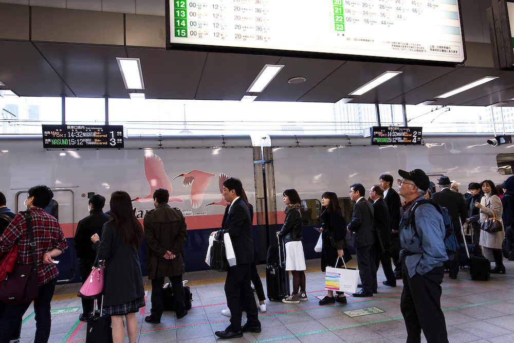 TOKYO, JAPAN - March 3 : Commuters waiting for bullet train is seen at Tokyo Station on March 3, 2015, Tokyo, Japan.<br />   <br /> Photo: Richard Atrero de Guzman