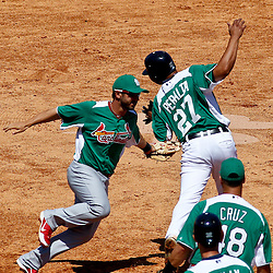 March 17, 2012; Lakeland, FL, USA; St. Louis Cardinals second baseman Daniel Descalso (33) tags out Detroit Tigers shortstop Jhonny Peralta (27) to complete a double play and end the fourth inning of a spring training game at Joker Marchant Stadium. Both teams wore green jerseys and the field was marked with shamrocks for the St. Patrick's Day game. Mandatory Credit: Derick E. Hingle-US PRESSWIRE