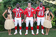 KO OLINA - FEBRUARY 10:  San Diego Chargers 2005 NFL Pro Bowl AFC All-Stars (left to right: LaDainian Tomlinson #21, Drew Brees #9, and Antonio Gates #85) pose with Hawaiian Hula girls for their 2005 NFL Pro Bowl team photo on February 10, 2005 in Ko Olina, Hawaii. ©Paul Anthony Spinelli