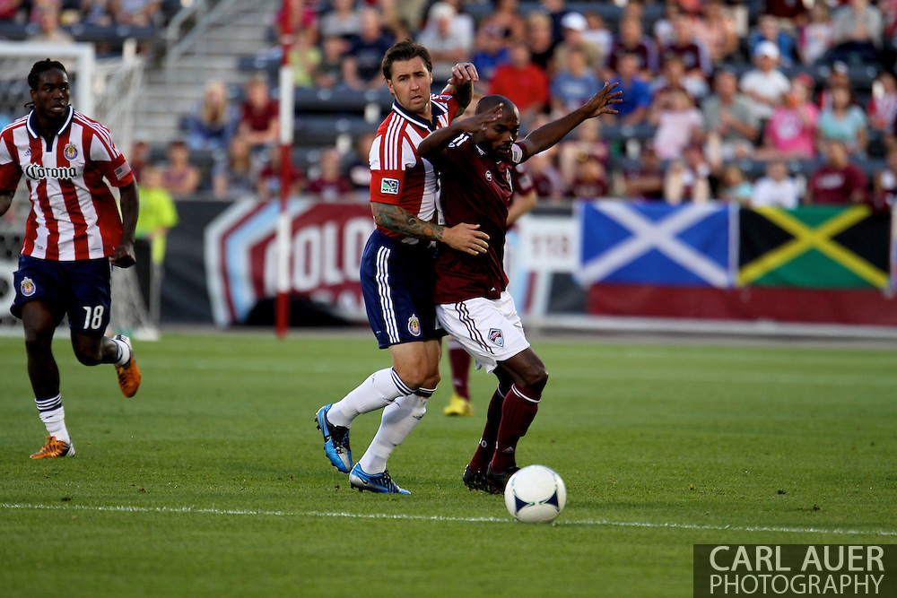 August 18th, 2012: Colorado Rapids forward Omar Cummings (14) tries to keep the ball away from Chivas USA defender Danny Califf (23) in the first half at Dick's Sporting Goods Park