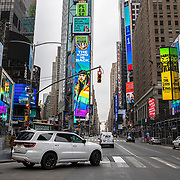 A digital billboard in Times Square advertises a new release by rapper Daniel Hernandez aka Tekashi 6ix9ine, as Times Square remains virtually empty due to the Coronavirus (Covid-19) outbreak in New York City, New York on Friday, May 8, 2020.  (Alex Menendez via AP)