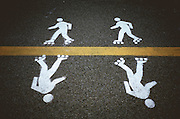 painted white skater figures on asphalt