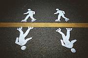 painted white skater figures on asphalt