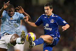 MANCHESTER, ENGLAND - Monday, February 25, 2008: Everton's Tim Cahill and Manchester City's Micah Richards during the Premiership match at the City of Manchester Stadium. (Photo by David Rawcliffe/Propaganda)