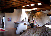 Yabba dabba do! Flintstones home carved into Arizona boulders once called 'the most original home in America' is on sale for $4.2million<br /> <br /> An Arizona home that was once dubbed the most original home in America because 60 per cent of it is constructed from granite boulder has gone on the market for $4.2million.<br /> The 4,380-square-foot home sits on nine acres of Scottsdale, Arizona desert. With three bedrooms and two-and-a-half bathrooms, the home is made from only 40 per cent non-rock material.<br /> Ancient petroglyphs carved into the home's exterior led it to be put on the National Register of Historic Places after being built in 1980.<br /> The home, which is surrounded by Whisper Rock Golf Course and has been featured in more than 30 publications, has been carved out of boulders, according to Estately.<br /> The walls, floors and ceilings flow from rock to stucco and create an extraordinary earthy feel for those who enter. <br /> Former CEO of Neiman Marcus, Stanley Marcus, once called it the most interesting home in America.<br /> ©Sothebys International/Exclusivepix Media