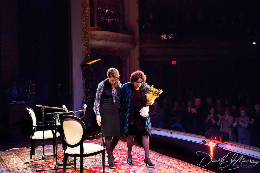NHPR's Virginia Prescott and US Supreme Court Justice Sonia Sotomayor walk off stage to a standing ovation at the end of a Writers on a New England Stage show at The Music Hall in Portsmouth, NH