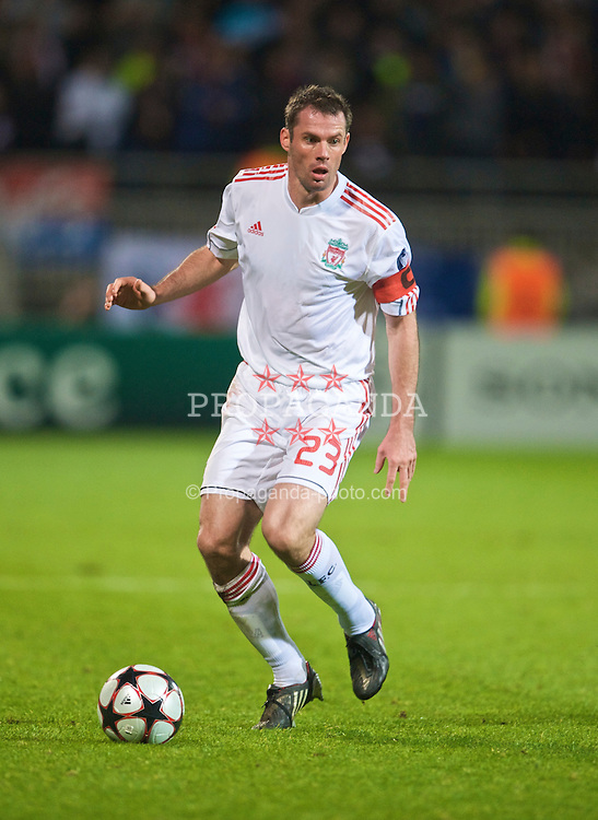 LYON, FRANCE - Wednesday, November 4, 2009: Liverpool's captain Jamie Carragher in action against Olympique Lyonnais during the UEFA Champions League Group E match at Stade Gerland. (Pic by David Rawcliffe/Propaganda)