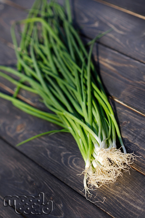 Close up of chives on wooden table