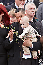 © Licensed to London News Pictures.  17/05/2012. CARTERTON, UK. Friends and family of Lance Corporal Lee Davies pay their respects during a double repatriation ceremony.Corporal Brent McCarthy, of the Royal Air Force Police, and Lance Corporal Lee Davies of 1st Battalion Welsh Guards were killed in Afghanistan May 12 by a man dressed in an Afghan Police uniform.  Photo credit :  Cliff Hide/LNP