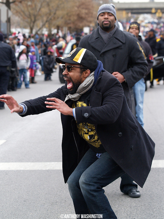 A member of Alpha Phi Alpha Fraternity, Inc performs during the Dr. Martin Luther King, Jr. Parade in Baltimore, MD on Monday, January 17, 2011.