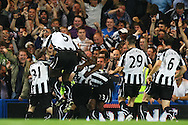 London - Wednesday September 22nd 2010: The Newcastle players celebrate Shola Ameobi's late winning goal in front of their fans during the Carling Cup 3rd Round match at Stamford Bridge, London. (Pic by Paul Chesterton/Focus Images)