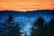 Portlandia Moment.  Portland sunset from Mount Tabor Park.  In 1903, John Charles Olmsted of the Massachusetts-based landscape design firm Olmsted Brothers recommended that a city park be developed at Mount Tabor.  Portland Parks Superintendent Emanuel T. Mische, who had worked at Olmsted Brothers, consulted with Olmsted on the park layout and integration of the reservoirs into the park design.  Photo: 5 February 2012.