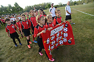 FALLS TOWNSHIP, PA - SEPTEMBER 06: Members of the Bombers march on field during the opening day parade of Falls Soccer Club September 6, 2014 at Falls Community Park in Falls Township, Pennsylvania. (Photo by William Thomas Cain/Cain Images)