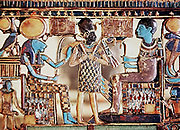 Ptah (Phthah), right, creator of universe and patron of craftsmen, and his consort Sekhmet (Sekhet), left, lion-headed goddess of war, wearing solar disk and uraeus, pharoah with regalia between them. Further gods either side. Ancient Egypt. Pectoral jewe