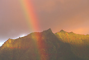 Rainbow over Mount Kaupaopu at sunset, North Shore, Island of Kauai, Hawaii