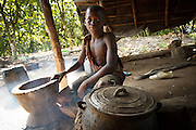 Firimin Kouassi, 13, cooks on his uncle's cocoa plantation near the town of Moussadougou, Bas-Sassandra region, Cote d'Ivoire on Monday March 5, 2012. Firimin decided to abandon school.