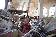 A statue from a holiday creche display peeks out from the remains of the Sacre Coeur Catholic church in Port-au-Prince, Haiti, Friday, February 28, 2010.  The church was ruined in the January 12 earthquake.