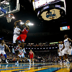 January 3, 2011; New Orleans, LA, USA; Philadelphia 76ers point guard Lou Williams (23) shoots over New Orleans Hornets center Emeka Okafor (50) during the second quarter at the New Orleans Arena.   Mandatory Credit: Derick E. Hingle