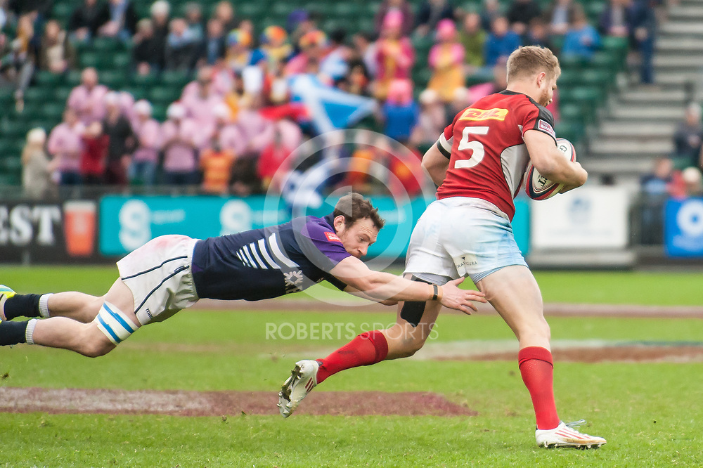 Canada's Conor Trainor breaks through the Scotland defence. Action from the IRB Emirates Airline Glasgow 7s at Scotstoun in Glasgow. 4 May 2014. (c) Paul J Roberts / Sportpix.org.uk