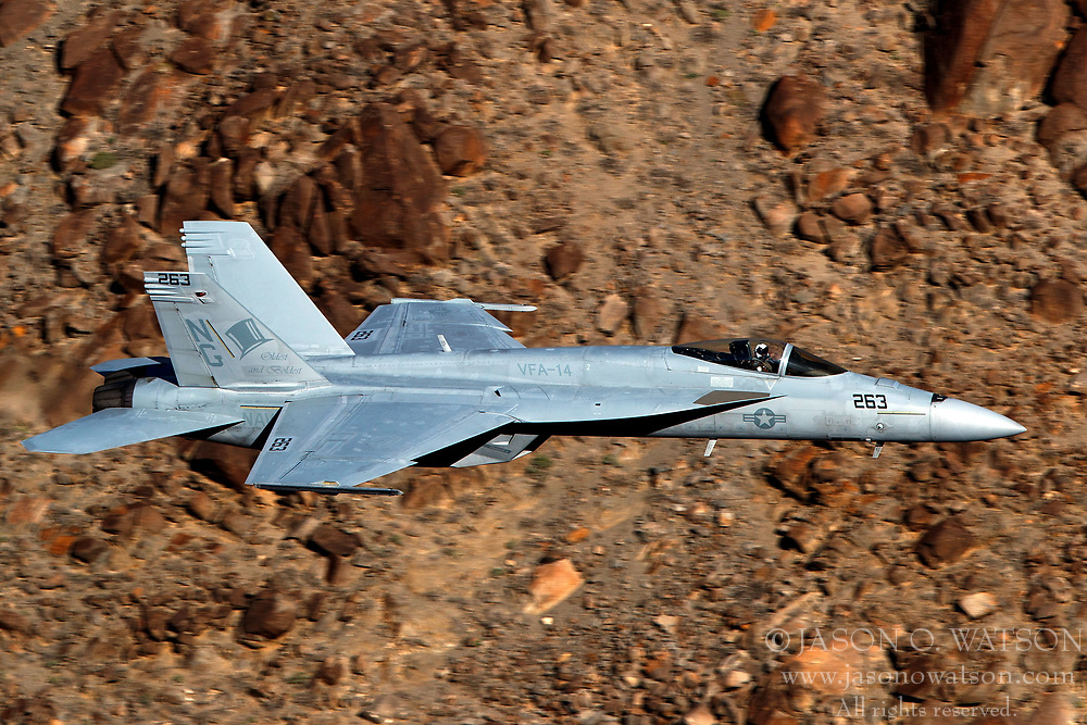 United States Navy Boeing F/A-18E Super Hornet (NG-263) of the VFA-14 Tophatters squadron from Naval Air Station Lemoore, flies low level through the Jedi Transition, Star Wars Canyon, Death Valley National Park, California, United States of America