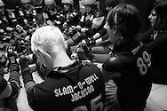 Raging Warmones skaters gather in the locker room for a pre-bout discussion at the C-Max Roller Derby league Deathrow Demolition Derby, July 28 2012. The Raging Warmones versus the Thundering Hellcats, Johannesburg, South Africa.