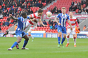Andrew Butler (6) of Doncaster Rovers heads the ball to score and go 1 all  during the Sky Bet League 1 match between Doncaster Rovers and Wigan Athletic at the Keepmoat Stadium, Doncaster, England on 16 April 2016. Photo by Ian Lyall.
