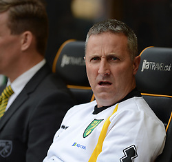 Norwich City new Manager, Neil Adams sits in the dugout prior to kick off. - Photo mandatory by-line: Alex James/JMP - Mobile: 07966 386802 10/08/2014 - SPORT - FOOTBALL - Wolverhampton - Molineux Stadium - Wolves v Norwich City - Sky Bet Championship
