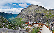 Trollstigen (the Troll's Ladder) is a steep (9% grade) mountain road with eleven hairpin turns in Rauma, Norway, part of Norwegian National Road 63 connecting Åndalsnes in Rauma and Valldal in Norddal. Surrounding the road is Reinheimen National Park, Norway's third largest. Trollstigen was opened 1936 by King Haakon VII after 8 years of construction. See impressive Stigfossen waterfall tumble 320 meters as you zig zag up or down this popular, mostly single-lane tourist road. Panorama stitched from 4 overlapping photos.