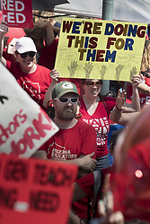 April 26, 2018 - Phoenix, Arizona, U.S - In the largest teacher strike in Arizona history, teachers demonstrated at the state capitol for a second day after walking out in Thursday April 26. They are demanding improvements to funding of schools. Thousands of teachers and supporters from all over the state converged to apply pressure to the governor and legislature. The state ranks 49th in per-pupil spending in the nation. Teachers decided to strike after the governor proposed a deal that increased teacher salaraies 20% over two years, but did no offer anything for support staff or general school funding to cover everything from  textbooks to facilities. Red for Ed reminds supporters to wear the color to express their support of teachers. (Credit Image: © Rick D'Elia via ZUMA Wire)