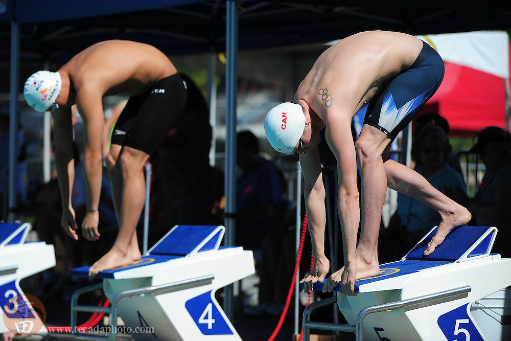 May 31, 2012; Santa Clara, CA, USA; Ryan Cochrane (CAN), right, and Taehwan Park (KOR), left, prepare to dive off the starting blocks during the men's 800-meter freestyle in the Santa Clara international grand prix at the George F. Haines International Swim Center.