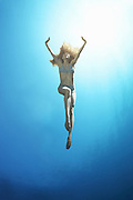 Girl ascending to underwater surface  <br /> Photography by Zac Macaulay<br /> Tel 0044 07947 884 517<br /> www.linkphotographers.com